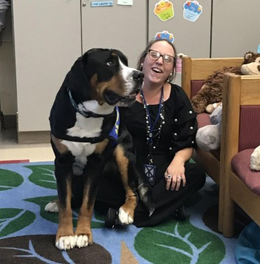 Schools using therapy dogs to relieve stress and promote learning